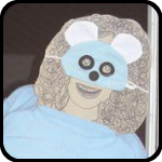 A Cardboard Woman Wearing A Blue Mouse Mask