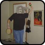 A Cardboard Woman With A Tambourine and Maracas
