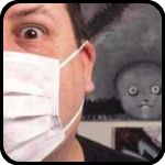 Weird Nik in face mask with weird thing peering over his shoulder.